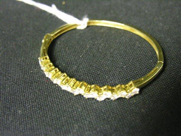 1595: THREE CARAT DIAMOND 18K GOLD BANGLE BRACELET