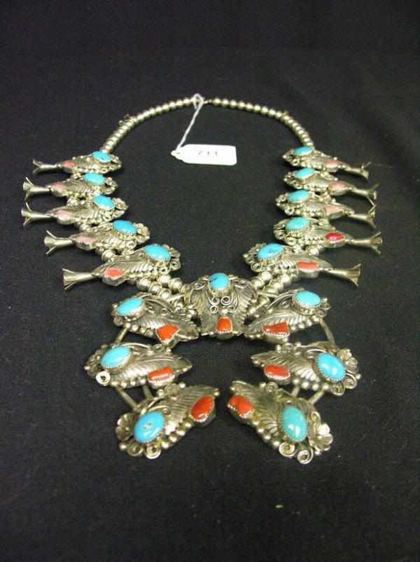 711: STERLING TURQUOISE AND CORAL SQUASH BLOSSOM NECKLA