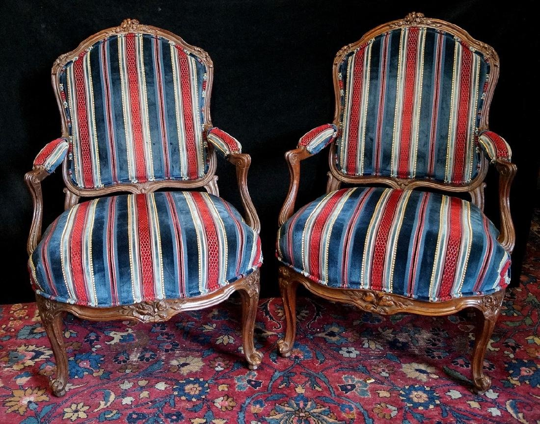PR. OF CARVED AND UPHOLSTERED LOUIS XV STYLE ARM CHAIRS