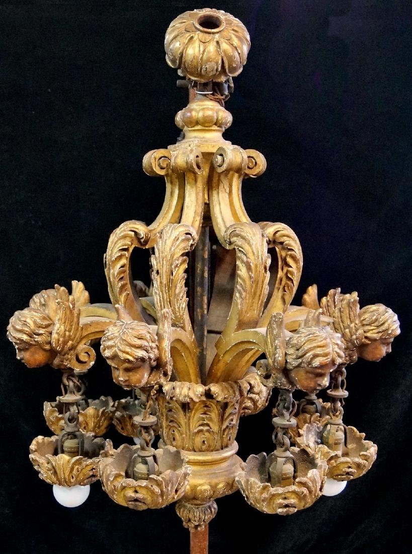 CALDWELL (?) FIGURAL CARVED WOOD 8 LIGHT CHANDELIER