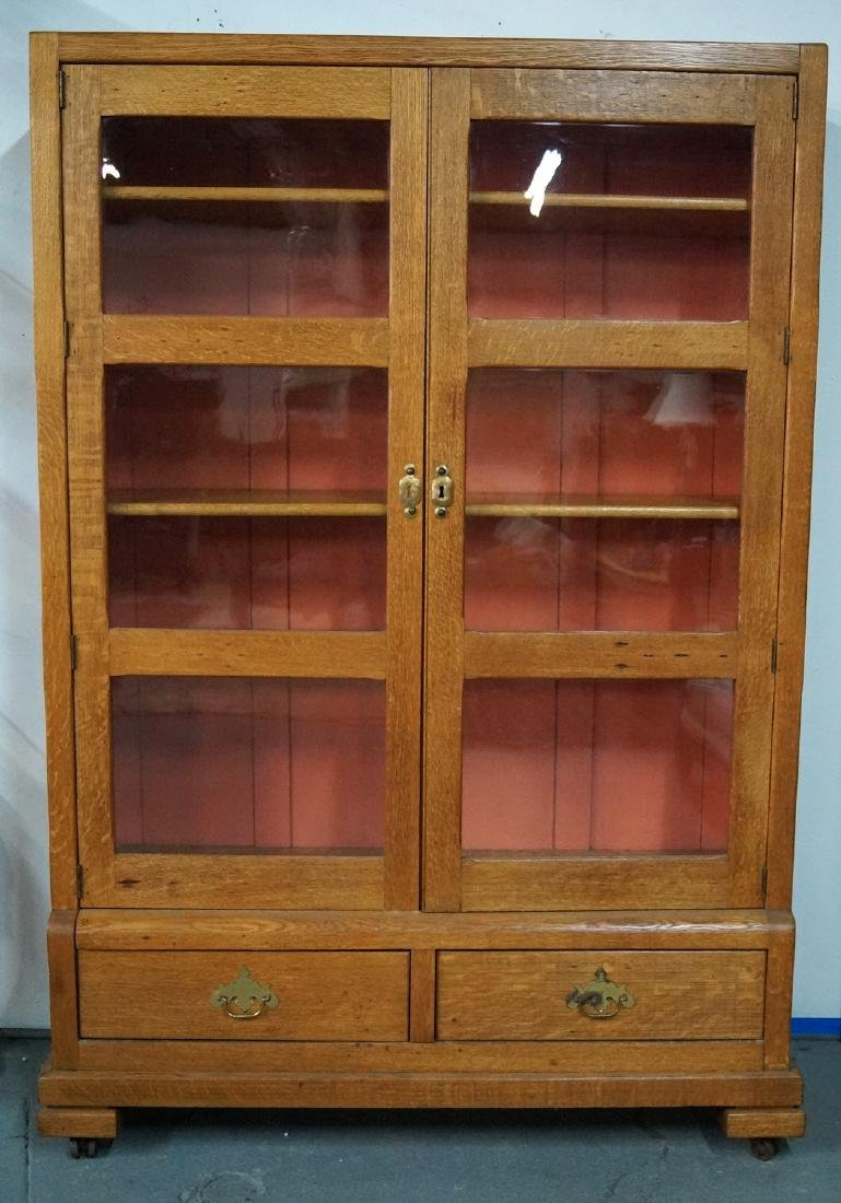 OAK STEP BACK GLASS DOOR BOOK CASE