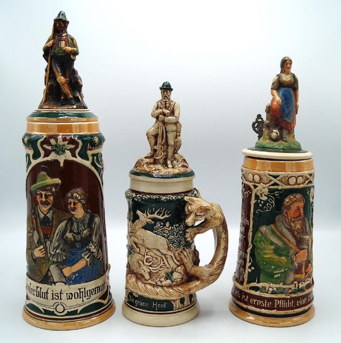 3 GERMAN STEINS FIGURAL LIDS