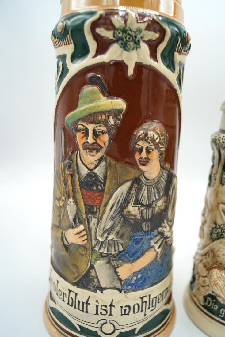 3 GERMAN STEINS FIGURAL LIDS - 3