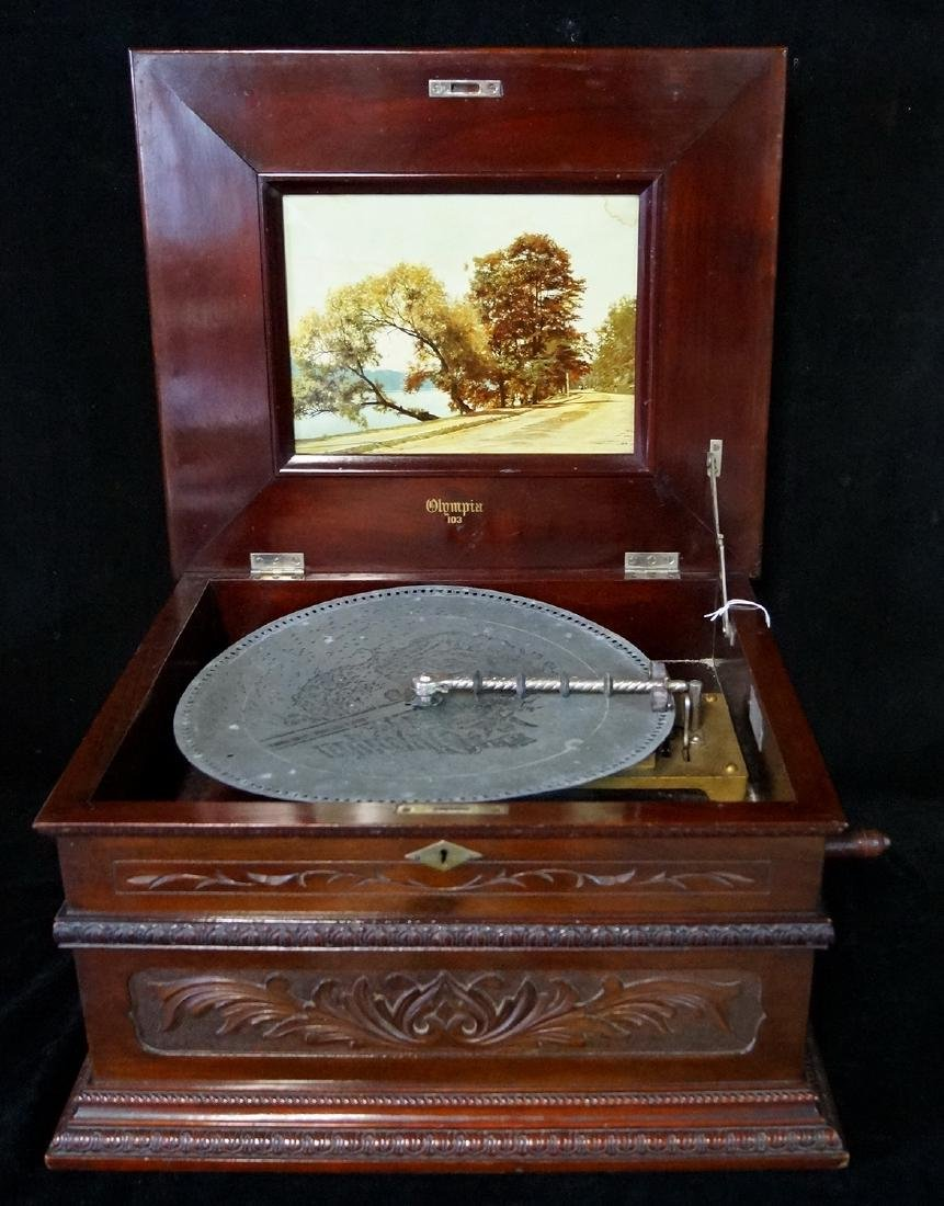 OLYMPIA CARVED CASE DOUBLE COMB DISK PLAYER