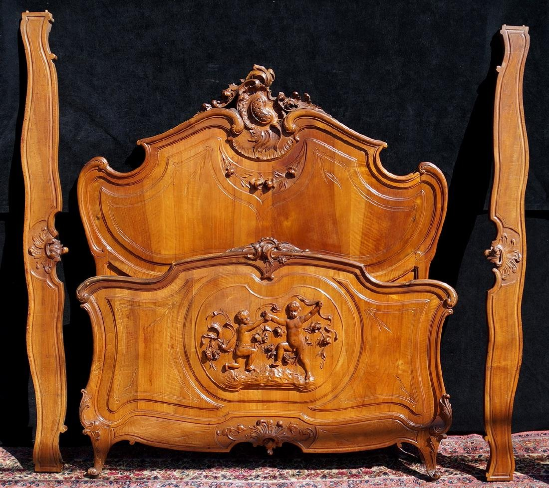 FRENCH WALNUT FIGURAL CARVED BED