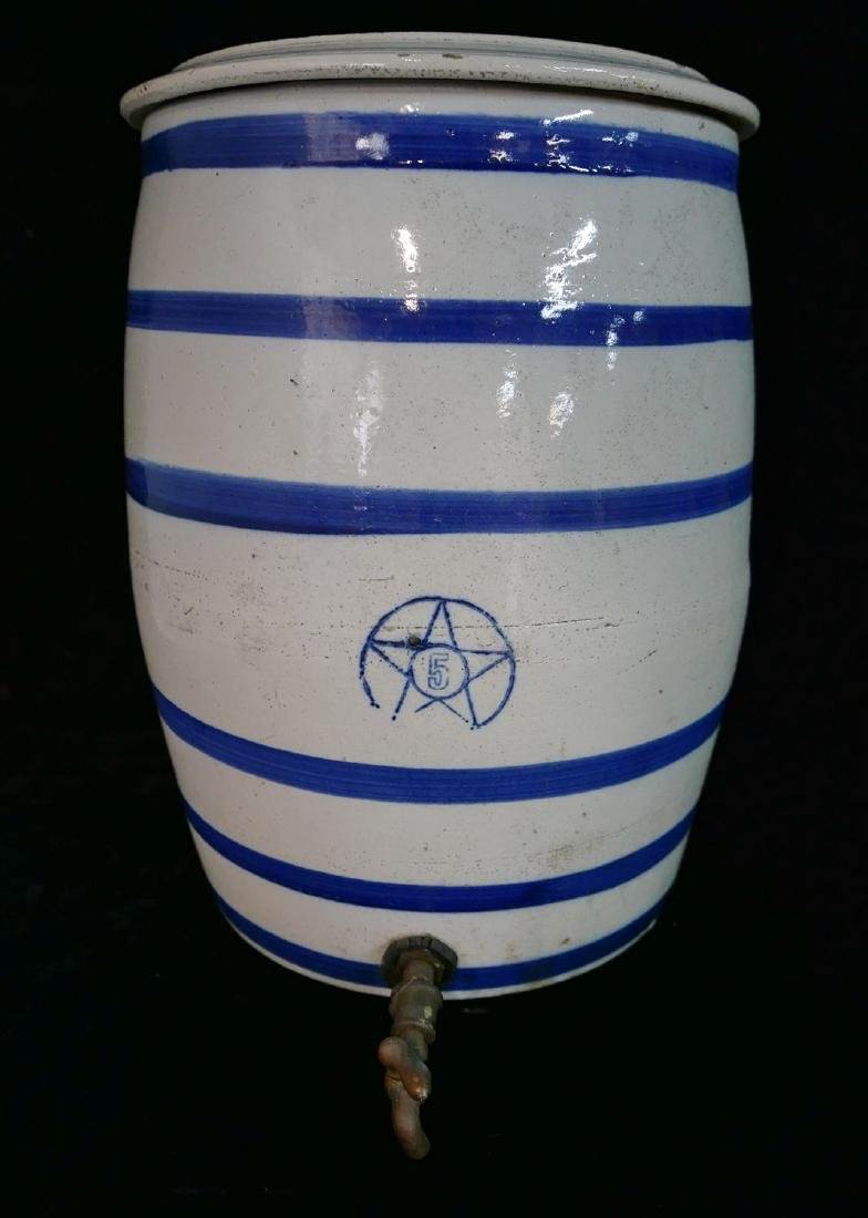 ANTHONY BARATTA: 5 GALLON BLUE & WHITE WATER JUG WITH