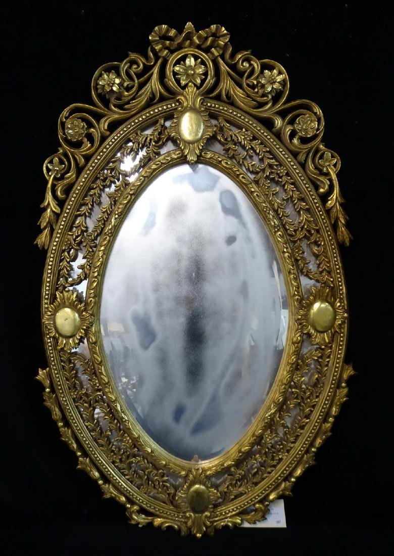 GILT CARVED OVAL WOOD MIRROR