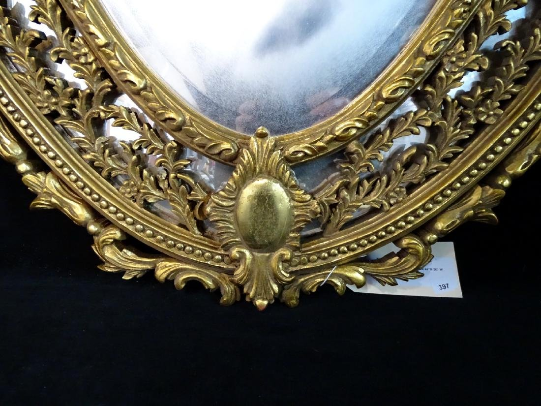 GILT CARVED OVAL WOOD MIRROR - 2