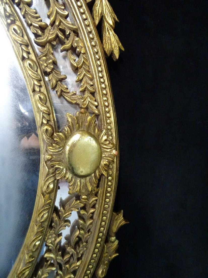 GILT CARVED OVAL WOOD MIRROR - 7
