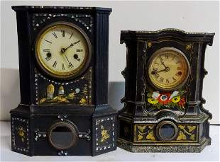 2 CAST IRON AND WOOD SHELF CLOCKS  W/MOTHER OF PEARL
