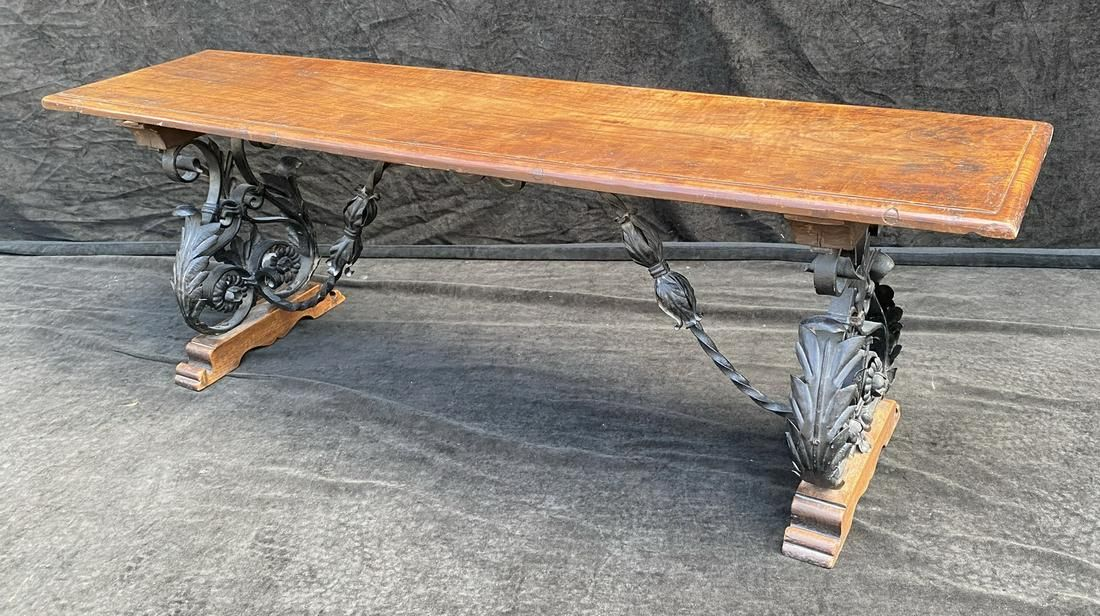 19TH C. WOODEN BENCH W/ ORNATE WROUGHT IRON STRETCHER