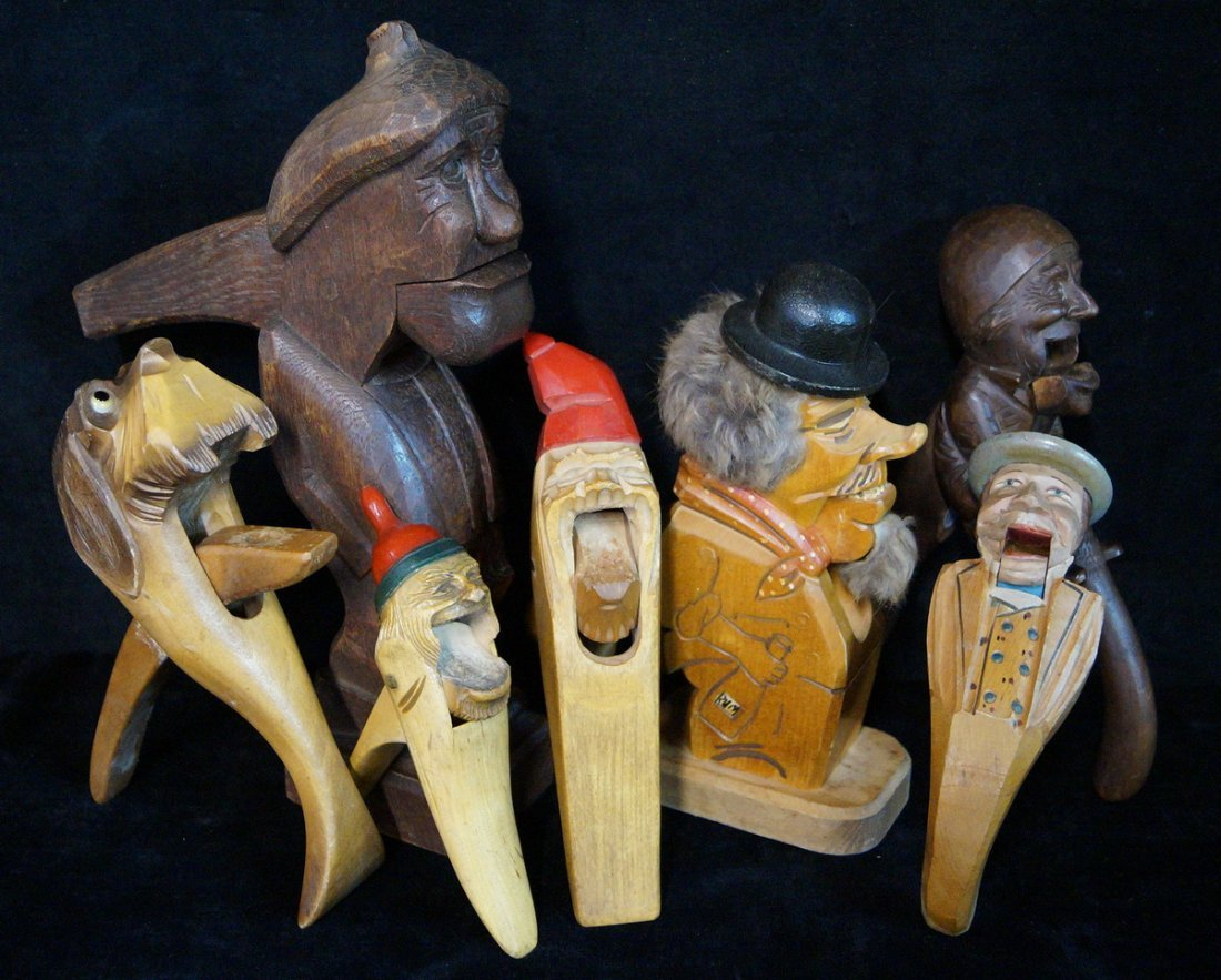 7 CARVED WOOD NUT CRACKERS