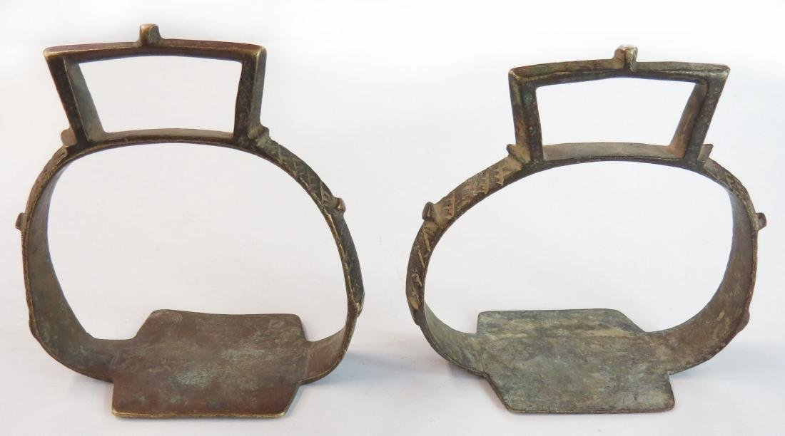 A PAIR OF 19th century INDIAN STIRRUPS Of characteristi