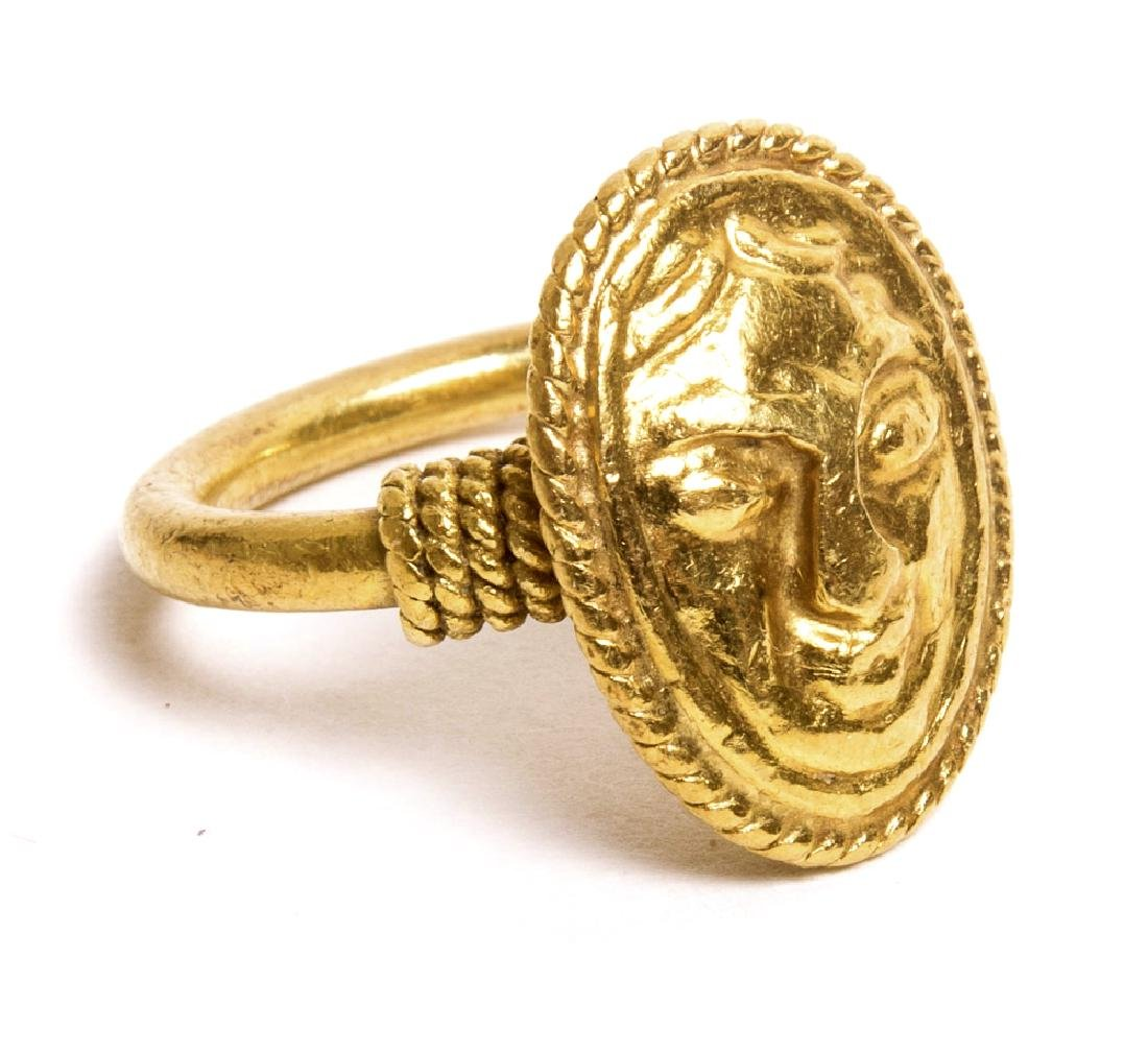 A Pre Columbian Style Gold finger Ring with Face