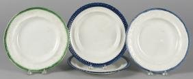 Four Staffordshire plates with green and blue bor