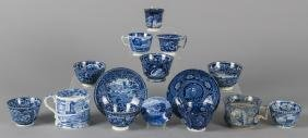 Group of blue Staffordshire cups, saucers and mug