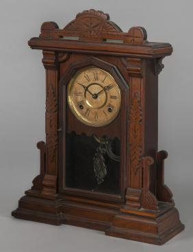 Walnut gingerbread clock, 21'' h.