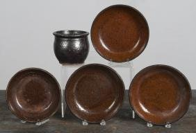 Four redware shallow bowls, together with a small
