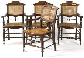 Four Victorian cane seat armchairs.