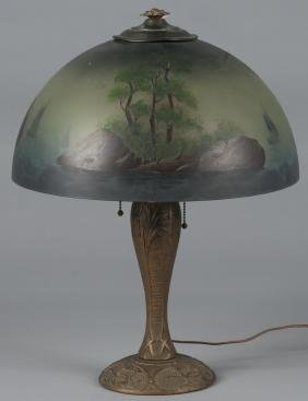 Gilt metal table lamp, early 20th c., with a reve