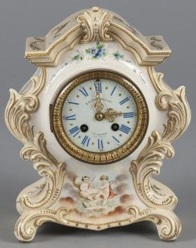 French porcelain mantel clock, retailed by J.E. C