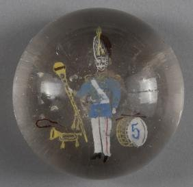 Colored frit paperweight, decorated with a drum m