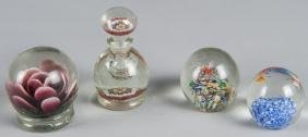 Four Chinese glass paperweight items, to include