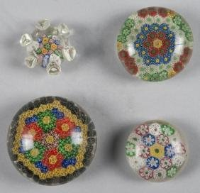 Four Chinese millefiori paperweights, to include