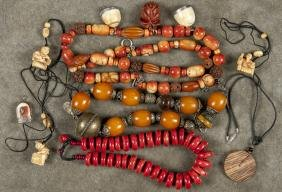 Group of Asian semi - precious stone necklaces, l