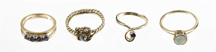 Four 14K yellow gold rings, to include examples s