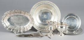 Group of sterling silver and silver mounted table
