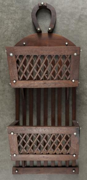 Pennsylvania Amish walnut horseshoe wall rack, 19