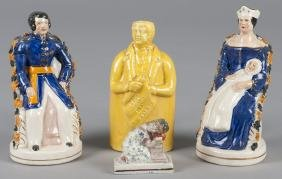 Pair of Staffordshire figures of a King and Queen