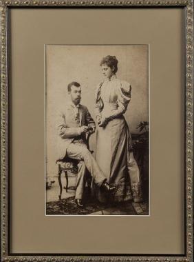 Three framed photographs of English royalty.