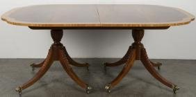 Baker Federal style mahogany dining table with th