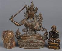 Tibetan bronze Buddhist figure together with a t