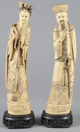 Pair of Chinese composition figures of an emperor
