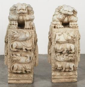 Pair of Chinese carved stone foo lions, 24'' h.