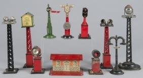 Collection of tin litho train accessories, some M