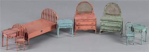 Eight pieces of Arcade cast iron dollhouse bedroo