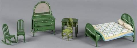 Six pieces of Arcade cast iron dollhouse bedroom