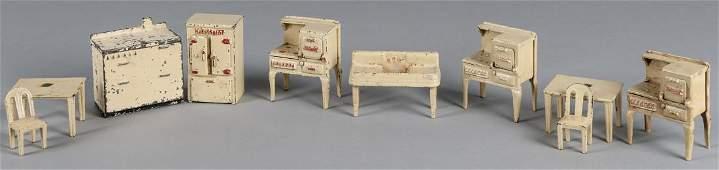 Ten pieces of Arcade cast iron dollhouse furnitur