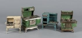 Four cast iron toy stoves, to include three Kento