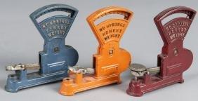 Three Kilgore cast iron Toledo toy counter scal