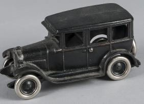 Arcade cast iron Ford four dour sedan, 8 1/4'' l.
