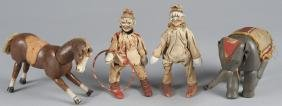 Four painted wood Schoenhut circus figures, to in