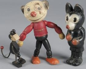 Three comic character figures, to include a compo