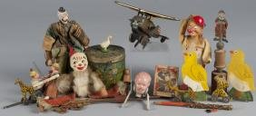 Group of miscellaneous toys, to include a tin win