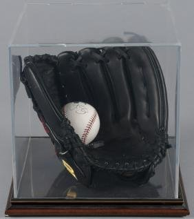 Curt Schilling signed baseball, with glove and di