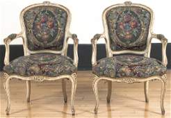 Pair of French painted fauteuils, mid 20th c.
